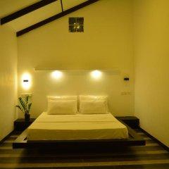 Отель Midigama Holiday Inn сейф в номере