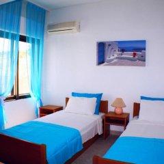 Отель Salonikiou Beach Deluxe Apartments Греция, Аристотелес - отзывы, цены и фото номеров - забронировать отель Salonikiou Beach Deluxe Apartments онлайн комната для гостей фото 4