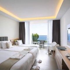 Отель The Royal Apollonia 5* Улучшенный номер с различными типами кроватей фото 3
