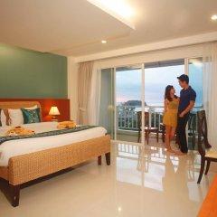 Отель Chanalai Flora Resort, Kata Beach 4* Улучшенный номер двуспальная кровать фото 6