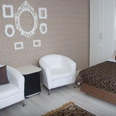 Мини-Отель Каприз Стандартный номер двуспальная кровать фото 4