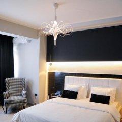 Отель TiranaTOP Suites Албания, Тирана - отзывы, цены и фото номеров - забронировать отель TiranaTOP Suites онлайн комната для гостей фото 3