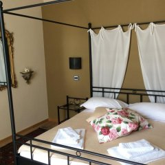 Отель Madama Cristina Bed & Breakfast комната для гостей фото 4