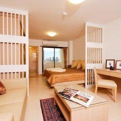 Апартаменты Sitara Place Serviced Apartments Бангкок комната для гостей фото 4