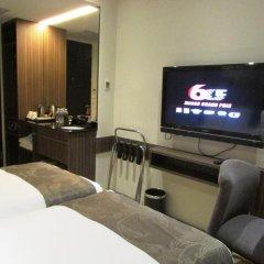 Отель Travelodge Harbourfront Singapore 4* Номер Делюкс с 2 отдельными кроватями фото 4