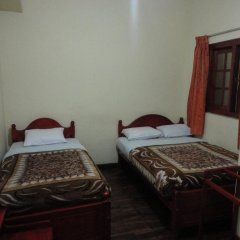 Отель New Nuwara Eliya Inn комната для гостей фото 4