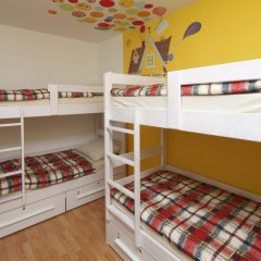 Pozitiv Hostel Кровать в общем номере с двухъярусной кроватью фото 14