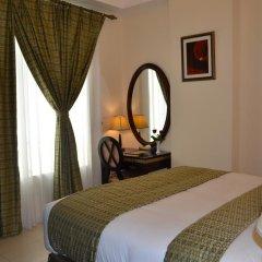 Отель Al Hayat Hotel Apartments ОАЭ, Шарджа - отзывы, цены и фото номеров - забронировать отель Al Hayat Hotel Apartments онлайн комната для гостей фото 12