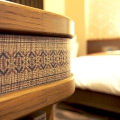 Отель Garden Palace Тэндзин удобства в номере