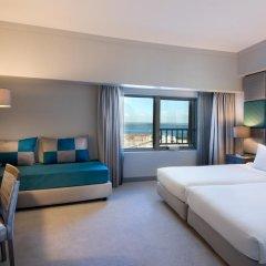 Отель Tivoli Oriente 4* Улучшенный семейный номер с двуспальной кроватью фото 3