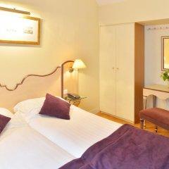 Отель Suites Unic Renoir Saint-Germain Франция, Париж - отзывы, цены и фото номеров - забронировать отель Suites Unic Renoir Saint-Germain онлайн комната для гостей фото 2