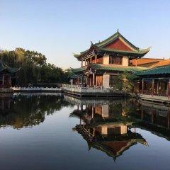 Отель Grand Park Kunming Куньмин приотельная территория
