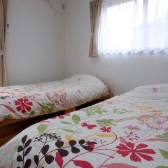 Отель Cottage Kutsuroki Япония, Якусима - отзывы, цены и фото номеров - забронировать отель Cottage Kutsuroki онлайн комната для гостей фото 5