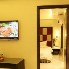 Отель The Flora Grand 4* Стандартный номер фото 4