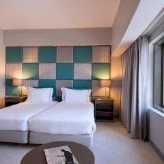 Отель Tivoli Oriente 4* Улучшенный номер с 2 отдельными кроватями фото 4
