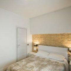 Отель J.R. Santa Maria Novella Luxury Rooms Италия, Флоренция - отзывы, цены и фото номеров - забронировать отель J.R. Santa Maria Novella Luxury Rooms онлайн комната для гостей фото 2