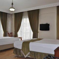 Basileus Hotel 3* Стандартный семейный номер разные типы кроватей фото 5