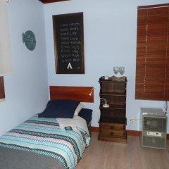 Отель Peniche Blue Wave Home сейф в номере
