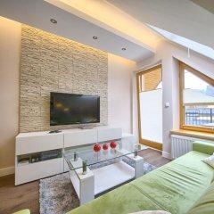 Апартаменты VisitZakopane Island Apartments комната для гостей фото 5