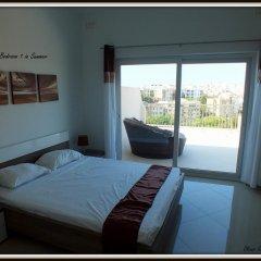 Отель Corner Penthouse комната для гостей фото 4