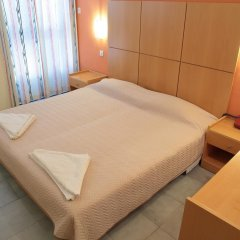 Achillion Hotel комната для гостей