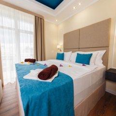 Гостиница Голубая Лагуна Люкс с двуспальной кроватью фото 8