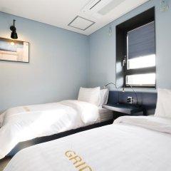 Отель Grid Inn 2* Стандартный номер с 2 отдельными кроватями