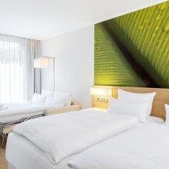 Отель NH Collection Berlin Mitte Am Checkpoint Charlie 4* Стандартный номер с разными типами кроватей фото 9