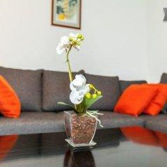 Апартаменты Apartment White Orchidea комната для гостей фото 4