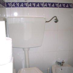 Отель Pensao Residencial Camoes 2* Стандартный номер с 2 отдельными кроватями (общая ванная комната)