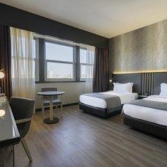 Отель HF Fénix Lisboa 4* Номер Комфорт с 2 отдельными кроватями фото 3