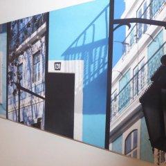 Отель Dobairro Suites at Principe Real Лиссабон интерьер отеля