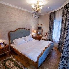 Гостиница Времена Года 4* Семейный номер Комфорт с двуспальной кроватью фото 4