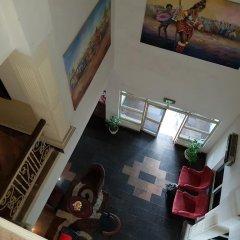 Отель Mangel Hotel And Suites Нигерия, Калабар - отзывы, цены и фото номеров - забронировать отель Mangel Hotel And Suites онлайн интерьер отеля