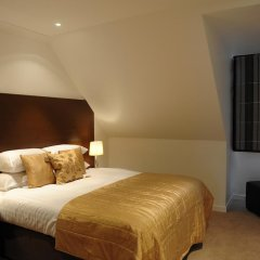 Апартаменты Fountain Court Apartments - Grove Executive комната для гостей фото 5