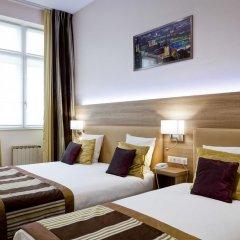 Отель Le Phénix Hôtel Франция, Лион - отзывы, цены и фото номеров - забронировать отель Le Phénix Hôtel онлайн комната для гостей фото 4