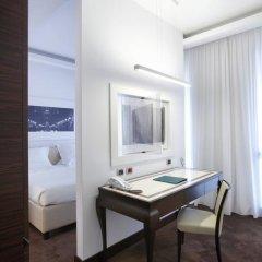 Отель UNAHOTELS Cusani Milano 4* Люкс с различными типами кроватей фото 2