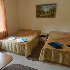 Гостевой дом Домашний Уют Стандартный семейный номер с двуспальной кроватью