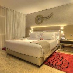 Отель NH Collection Porto Batalha 4* Улучшенный номер с различными типами кроватей фото 6