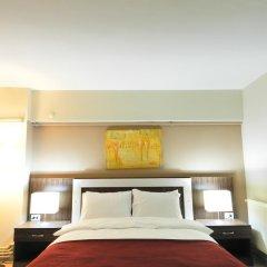 Отель Simal Airport Suites комната для гостей фото 4