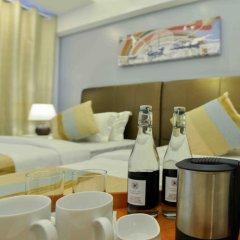 Отель Coconut Tree Hulhuvilla Beach Мале в номере