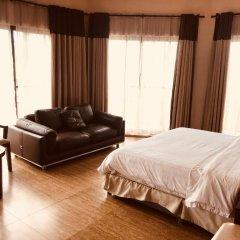 Отель L'Orchidee Hotel Республика Конго, Пойнт-Нуар - отзывы, цены и фото номеров - забронировать отель L'Orchidee Hotel онлайн комната для гостей фото 4