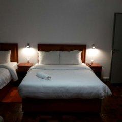 Отель Lx Center Guesthouse комната для гостей