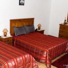 Отель Casa Do Brasao Стандартный семейный номер с двуспальной кроватью фото 19