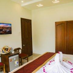 Отель Mi Kha Homestay 3* Улучшенный номер с различными типами кроватей фото 4