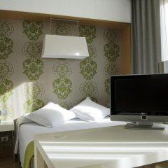 Отель NH Milano Touring 4* Стандартный номер разные типы кроватей фото 16