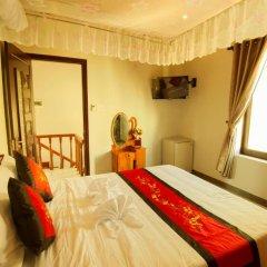 Отель Carambola Homestay 2* Улучшенный номер с различными типами кроватей фото 2