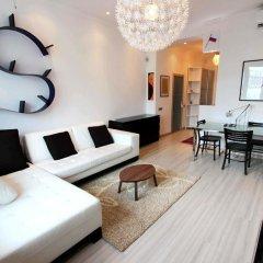 Апартаменты Four Squares Apartments on Tverskaya комната для гостей фото 4