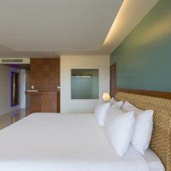 Отель Chanalai Flora Resort, Kata Beach 4* Улучшенный номер двуспальная кровать фото 3