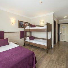 Отель Crystal Aura Beach Resort & Spa – All Inclusive 5* Стандартный семейный номер с двухъярусной кроватью фото 6